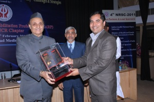 Dr Karan Singh, Member of India's Upper House of Parliament (left) presents the Best Professional Award to Mr Sibaji Panda (right), observed by Dr J.P. Singh, Member Secretary of the Rehabilitation Council of India (centre)