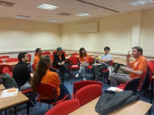 Participants discuss the  models, resources and implementation of sign language research