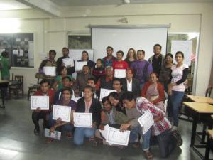 Deaf trainees receive their certificates of completion at the end of training