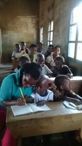 Graduate Aline Berahino teaching deaf pupils in Burundi