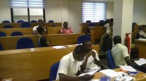 Participants at the Ghana workshop engage in discussions about literacy