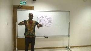 A Ghanaian participant explores different uses of literacy during the clock activity