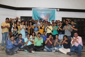 Workshop participants sign 'peer-to-peer'